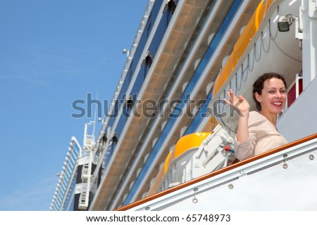 Smiling girl on ladder goes to the big cruise ship and wave by hand
