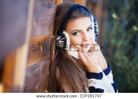 Smiling girl outside wearing woolen accessories