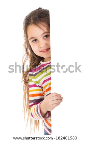 Smiling girl peek out from vertical empty white banner, isolated on white