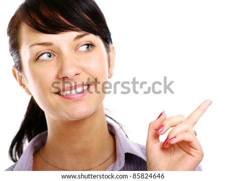 Smiling girl pointing at copyspace isolated