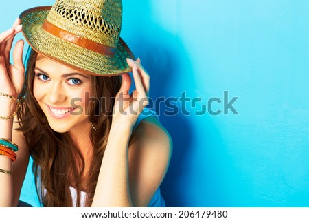 Smiling girl portrait. Girl hipster on blue background. Trilby yellow. Fashion portrait. - stock photo