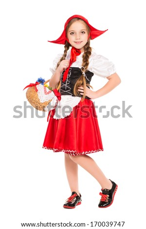 Smiling girl posing in a dress of little red riding hood. Isolated on white