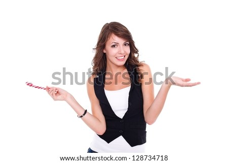 Smiling girl posing to camera with lollipop in hand - stock photo