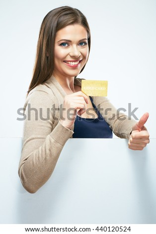 Smiling girl show credit card. Thumb up. White background isolated. - stock photo