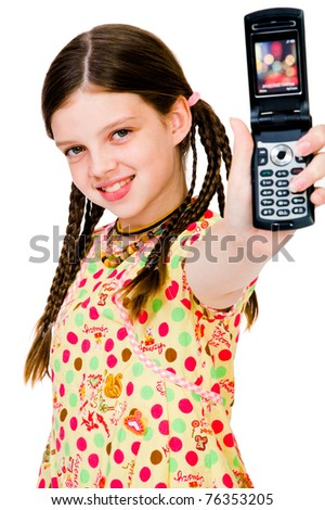 Smiling girl showing a mobile phone isolated over white - stock photo