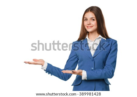 Smiling girl showing open hand palm with copy space for product or text. Business woman in blue suit, isolated over white background - stock photo