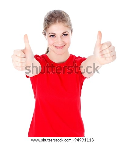 Smiling girl shows thumbs up over white background