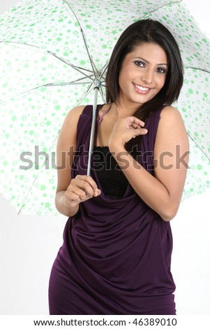 Smiling girl standing with umbrella - stock photo