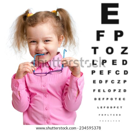 Smiling girl took off glasses with blurry eye chart behind her - stock photo