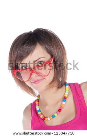 Smiling girl wearing funny-shaped glasses on white