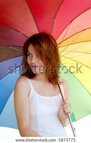 Smiling girl with a colorful umbrella - stock photo