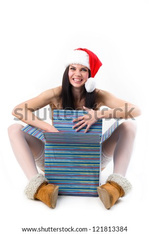 Smiling girl with a gift box - stock photo