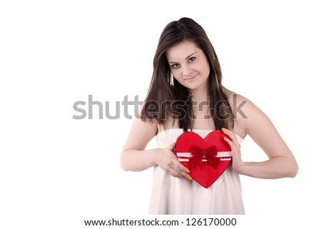 Smiling girl with a heart in her hands isolated on white studio shot