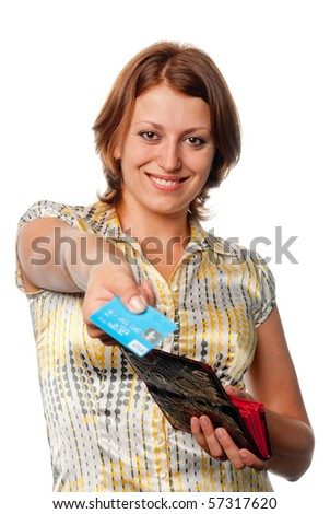 Smiling girl with a purse and credit card in hands