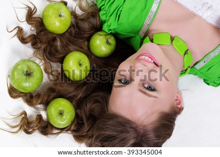 Smiling girl with appetizing apples, healthy food - stock photo