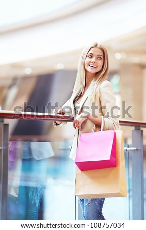 Smiling girl with bags in the store - stock photo