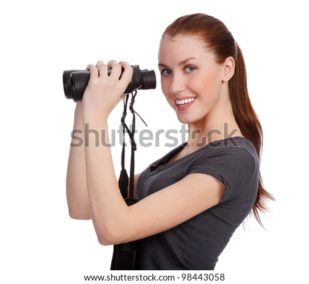 Smiling girl with binoculars posing against white background