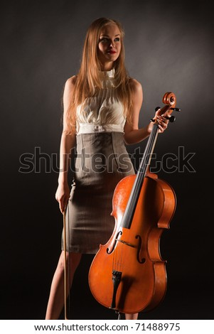Smiling girl with cello, studio isolated shot