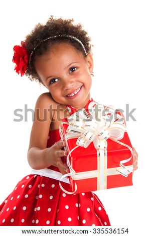 Smiling girl with curls hair give a  gift box in hands. Happy  New Year and christmas holidays - stock photo
