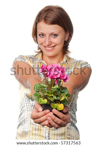 Smiling girl with cyclamens - stock photo