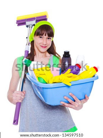 Smiling girl with detergents and mop - stock photo