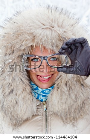 Smiling girl with glasses - stock photo