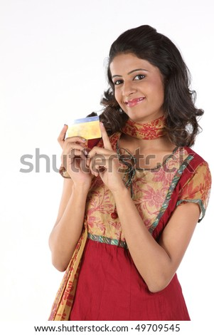 Smiling girl with gold card - stock photo