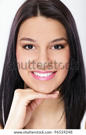 Smiling girl with healthy, white teeth - stock photo