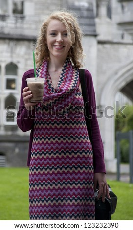 smiling girl with iced coffee - stock photo