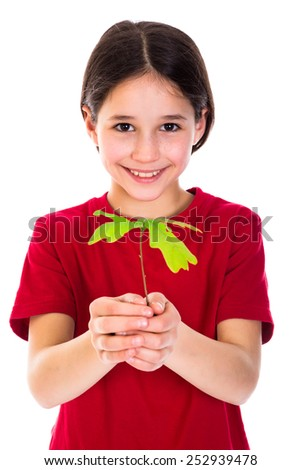 Smiling girl with oak sapling in hands, isolated on white - stock photo