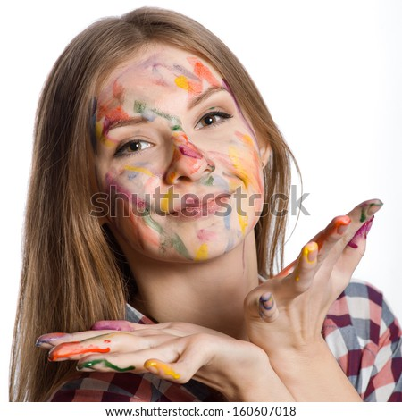 smiling girl with painted face and hands in colorful paints, isolated on white