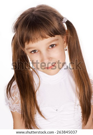 Smiling girl with pigtails looks at you in a white blouse on a white background
