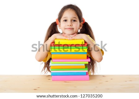 Smiling girl with pile of books, isolated on white
