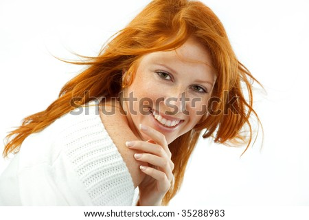 Smiling girl with red hair and green eyes isolated on white studio background - stock photo
