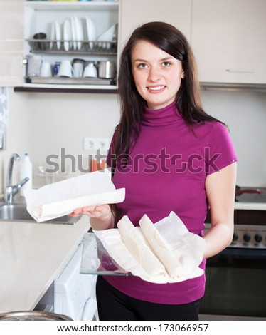 Smiling girl with store-bought dough at home