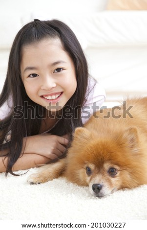 smiling girl with the Pomeranian