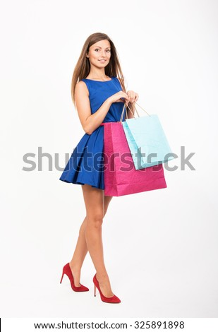 Smiling girl with the shopping bags - stock photo
