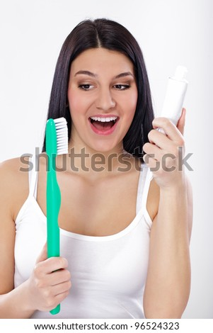 Smiling girl with toothbrush and tooth paste, concept- protection