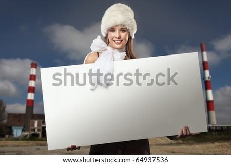 Smiling girl with white board