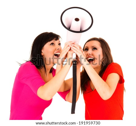 smiling girls friends with megaphone, white background - stock photo