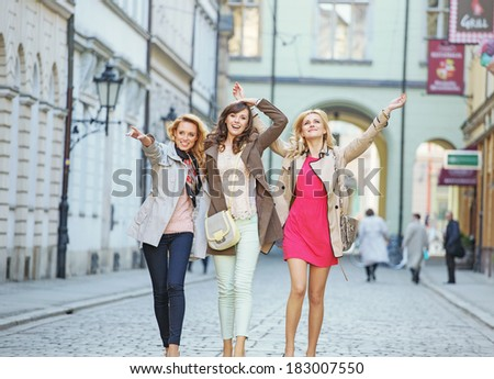 Smiling girls in the city - stock photo