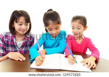 Smiling girls studying - stock photo