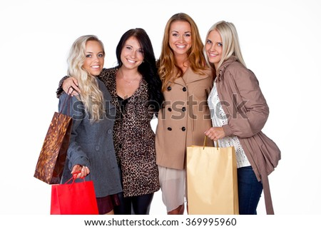 Smiling girls with shopping bags - stock photo