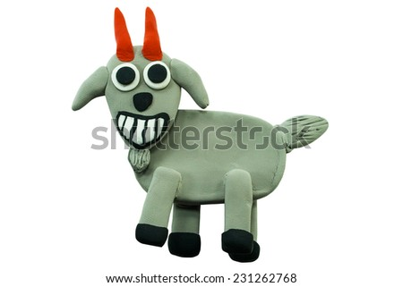 Smiling goat made from plasticine on white background - stock photo