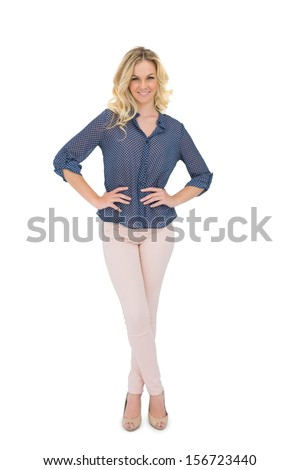 Smiling gorgeous blonde wearing classy clothes posing on white background - stock photo