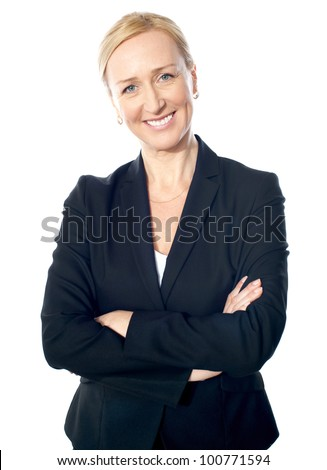 Smiling gorgeous business lady posing with crossed arms - stock photo