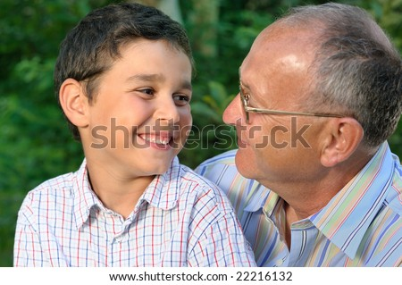 Smiling Grandfather and kid