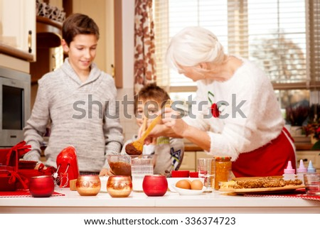 Smiling grandmother baking cookies with young grandchild. Christmas time. Happiness content.