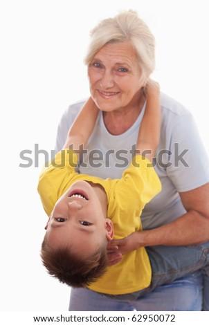 smiling grandparent with grandson - stock photo