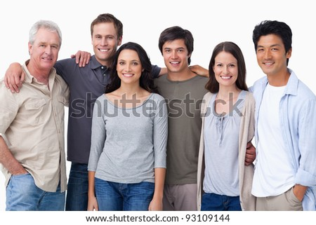 Smiling group of friends against a white background - stock photo